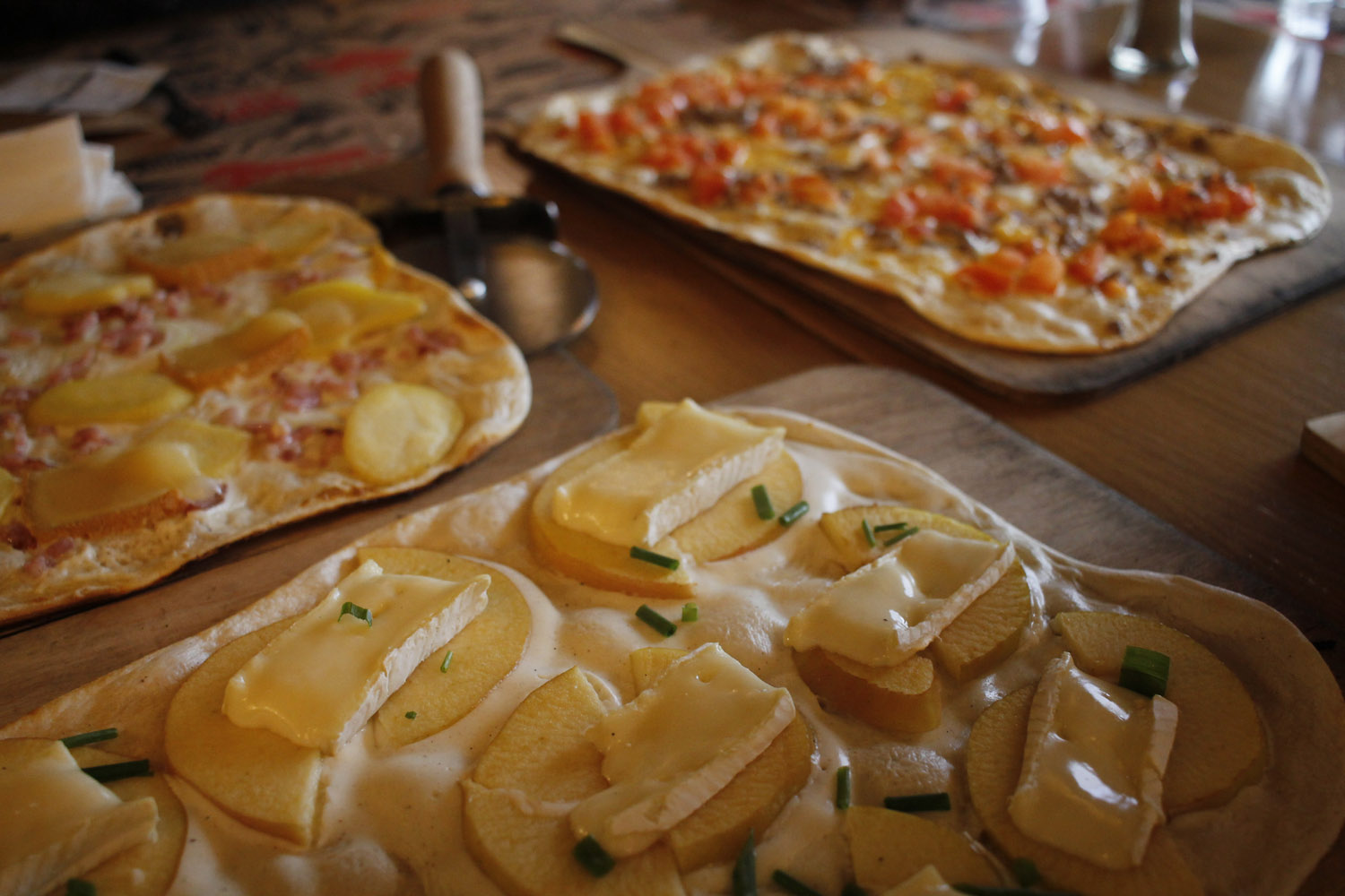 Selection of flammekueche, a traditional dish to share between friends.